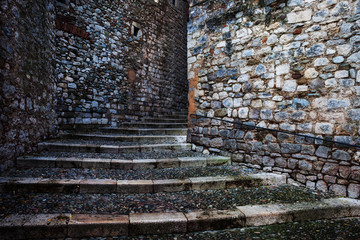 Medieval Stone Walls And Cobblestone Stairs In Girona