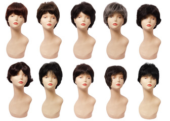 wig of hair on the mannequin, plastic head. Isolated on white background
