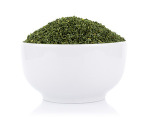 dried parsley in bowl isolated on white background