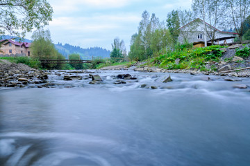 Mountain river with clean cold water and stones