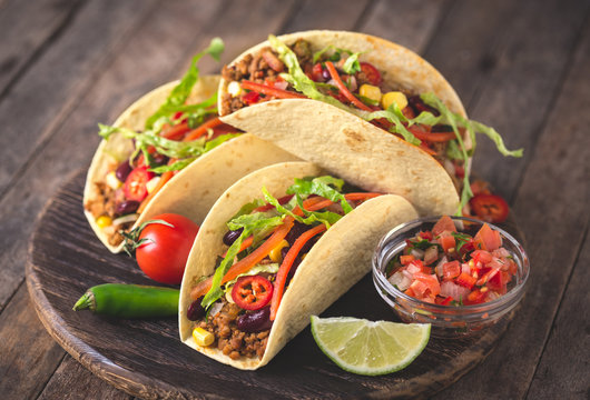 Mexican tacos with beef, vegetables and spices