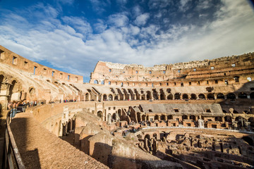 Tourists visiting the interior of Colosseum in Rome, Italy