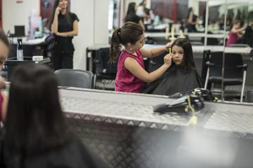 Little girls in hairdresser school