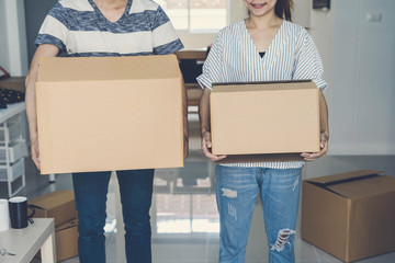 Young happy couple moving in new home