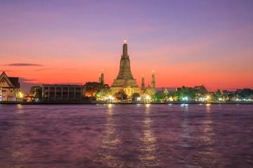 Big pagoda in Wat Arun Ratchawararam Ratchawaramahawihan / Wat Arun Landmark of Thailand in Sunset time