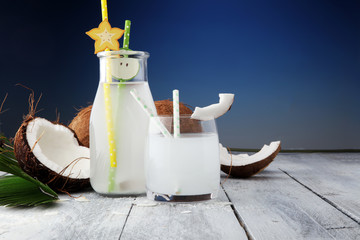 Coconut juice, Drink coconut water and coconuts on wooden background