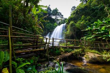 beautiful waterfall in northern Thailand, name Pha dok siew waterfall in Doi intanon national park with bamboo bridge