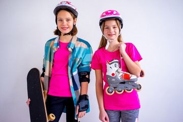 Teens with skateboards and rollerskates