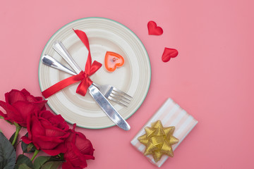 Valentines day table setting with plate On pink background