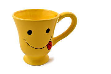 Yellow happy mug stock images. Yellow mug on a white background. Happy face cup