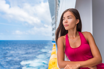 Cruise ship luxury travel Europe holiday in Mediterranean sea or European destination. Elegant chinese woman on deck portrait.