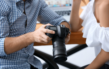 Two young photographers working in office