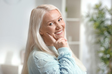 Portrait of beautiful mature woman at home