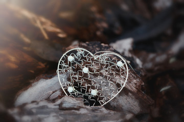 Golden decorative heart shape macro view