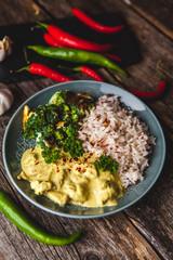 Handmade chicken curry tikka masala with basmati rice and brocco