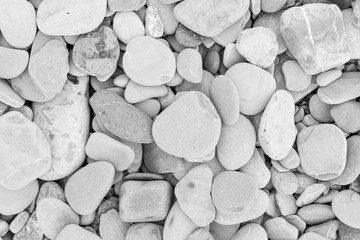 large grey pebble occupies the entire space of the frame, grey tone