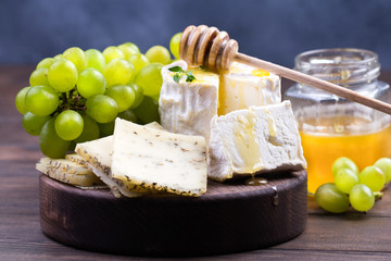French cheeses on wooden table