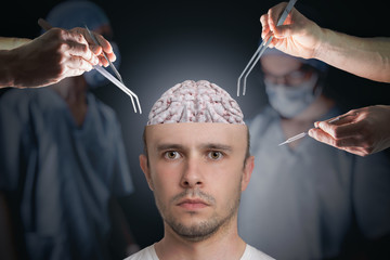 Neuroscience and neurosurgery concept. Surgeons during operation of brain.