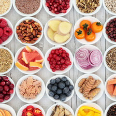 Healthy super food selection with fresh fruit, vegetables, fish, seeds, nuts, spice and herbs with foods high in omega 3 fatty acids, antioxidants, anthocyanins, fiber and vitamins.
