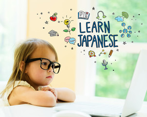 Learn Japanese text with little girl using her laptop