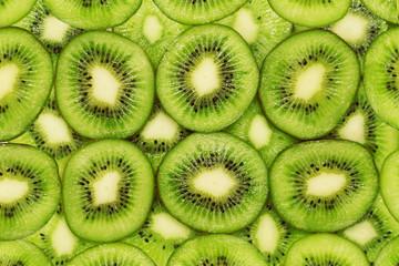 Kiwi fruit. Fresh juicy slices of ripe exotic fruit. Nature green background