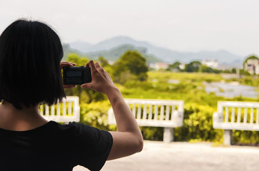 chinese woman taking pictures in Wuyishan