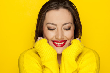 beautiful sexy woman in a yellow blouse on a yellow background