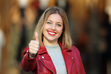 Fashion girl with thumb up looking at you