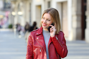 Fashion blonde calling on phone and looking at side