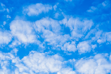 Beautiful spring blue sky with white feather clouds