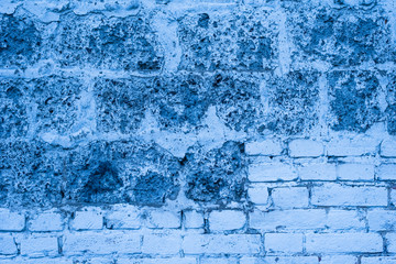 Vintage brick background with blue tint