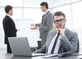 successful businessman sitting at Desk in office