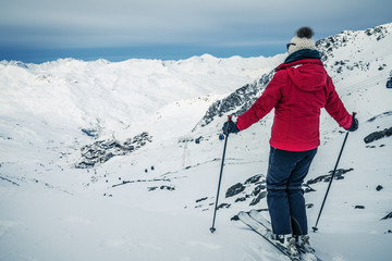Panorama of Val Thorens with skier