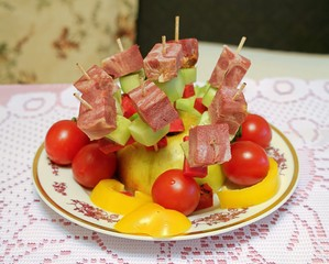 Сanapé on skewers with meat sliced, cherry, sweet pepper and cucumber