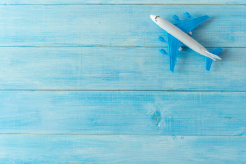 air plane miniature figure on light blue wood plank background Wall mural