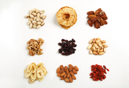 piles of Mixed dried fruits and nuts - symbols of jewish holiday Tu Bishvat