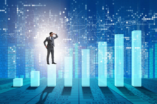 Businessman looking far in economic forecasting concept