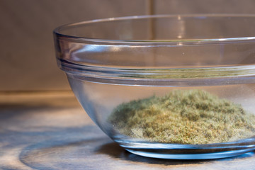 ground cannabis flower in a clear glass bowl.