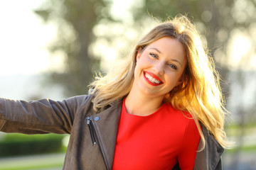 Portrait of a joyful fashion woman in a park