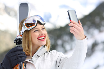 Skier taking a selfie with a smartphone
