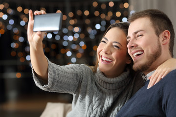 Couple taking selfies in winter at home