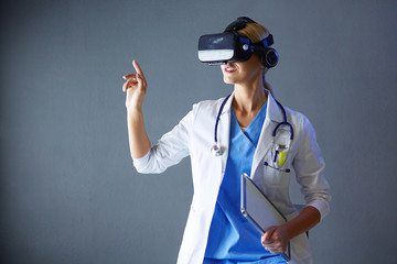 Female doctor wearing virtual reality glasses isolated on white background.
