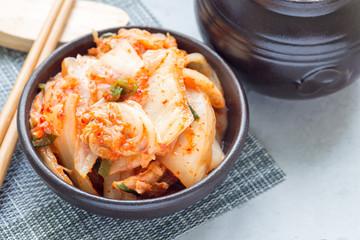 Kimchi cabbage. Korean appetizer in ceramic bowl, horizontal