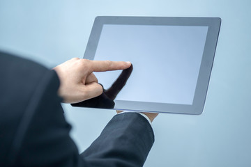 Businessman pressing tablet, technology, internet and networking concept