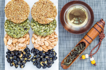 Korean traditional sweet snacks with peanuts, pumpkin seeds, black soybeans and chinese buckwheat. Healthy energy snacks. Top view, horizontal