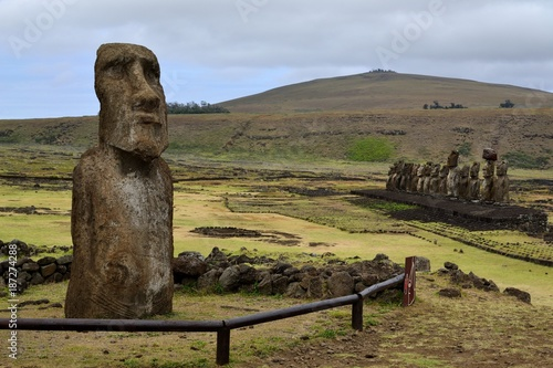 A solitary moai sits in front of Ahu Tongariki, with its