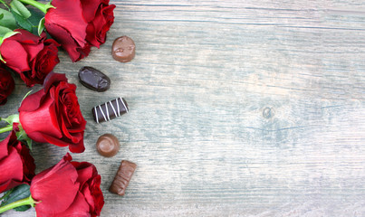Valentine's Day Red Roses Over Wooden Background With Chocolate Candy Pieces, Horizontal, Copy Space