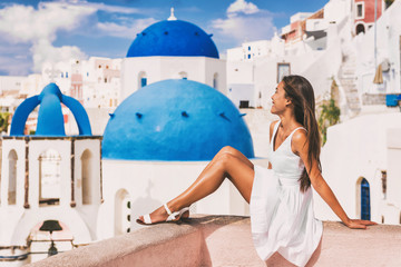 Wall Mural - Travel luxury Europe vacation woman at Blue Dome Church famous tourist attraction european destination in Oia, Santorini, Greek islands, Greece.