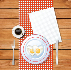 heart shaped fried eggs on white plate and clear sheet with space for text