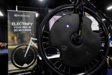 An Electron Wheel is shown on a bicycle during CES Unveiled at the 2018 CES in Las Vegas